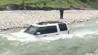 Land Rover submerged in water after man attempts to wash it in river
