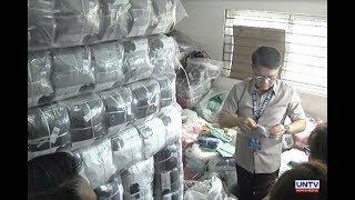 Smuggled luxury car at P700-M halaga ng pekeng damit, nasabat ng Bureau of Customs