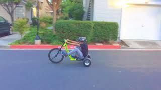Gavin trying to drift on my Big Wheel Razor