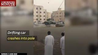 Drifting car crashes into pole