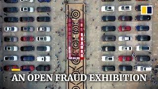 Chinese police showcase anti-fraud effort with US$10 million display of cars and cash