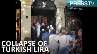 WATCH: Tourists storm luxury stores amid Turkey's currency collapse