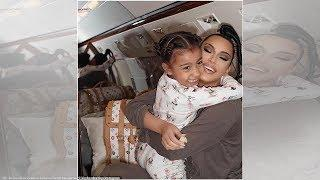 Kim Kardashian and daughter North cuddle in their PJs while flying to Montreal on a private jet